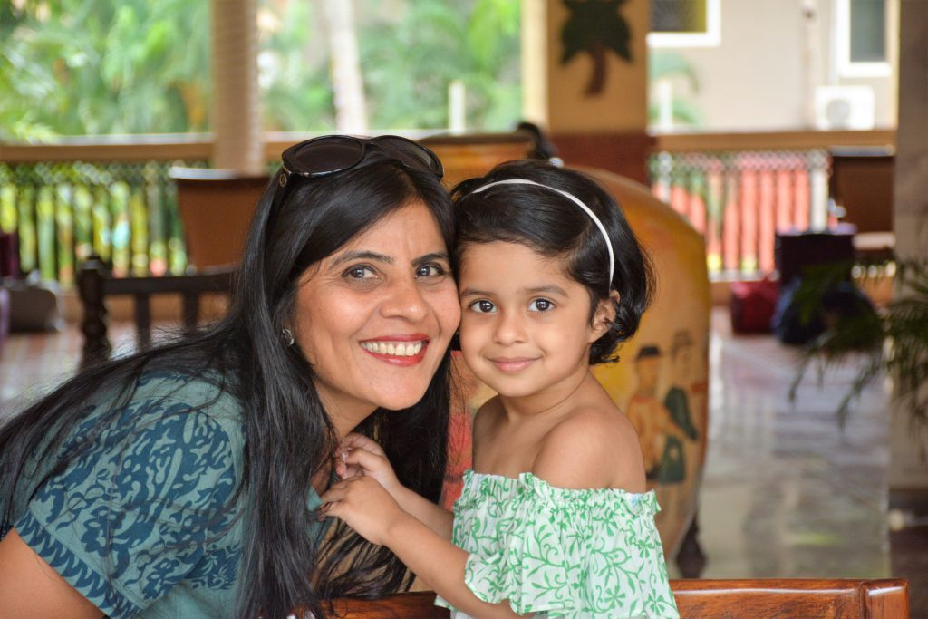 Cyclist renu singhi with her grand daughter.