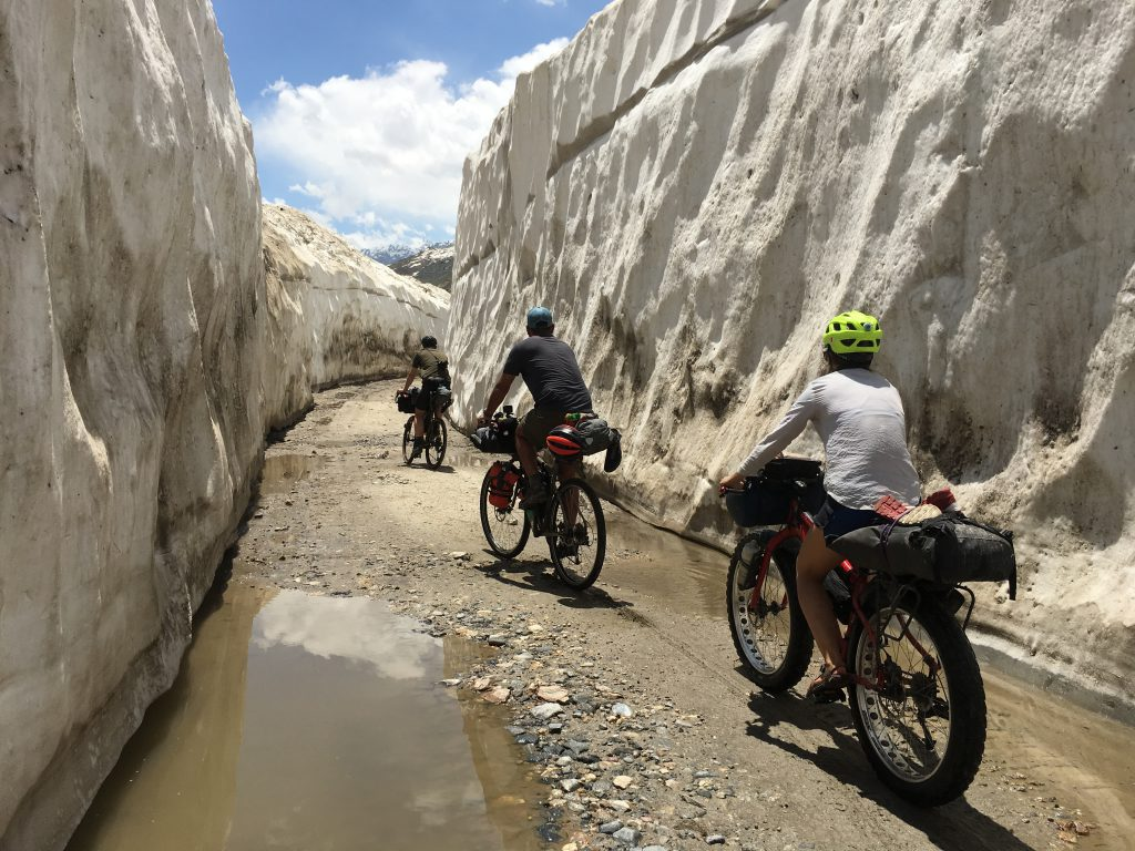 Cycling between ice walls on the route cleared by the BRO.