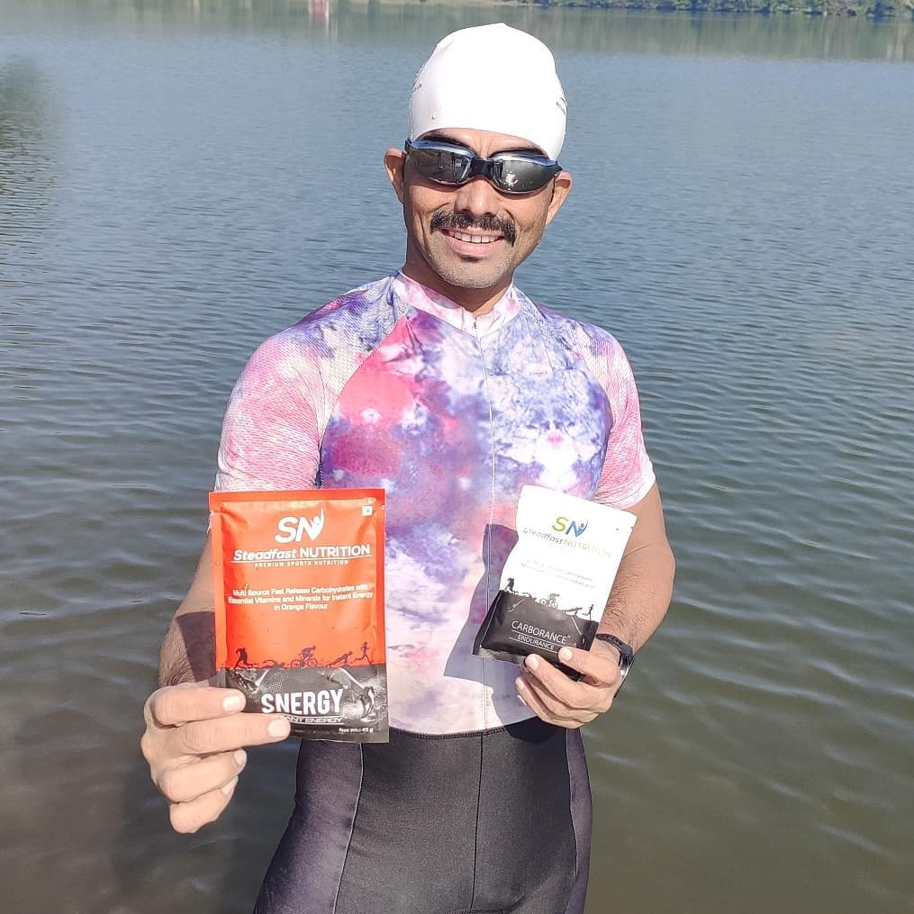 Man holding Steadfast Synergy pouches.